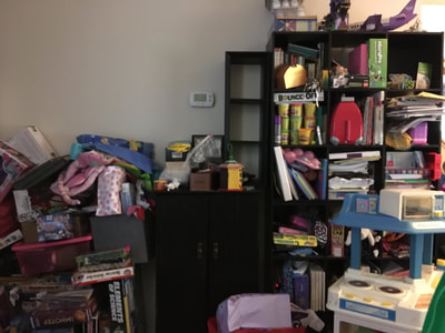 unorganized playroom toys and books